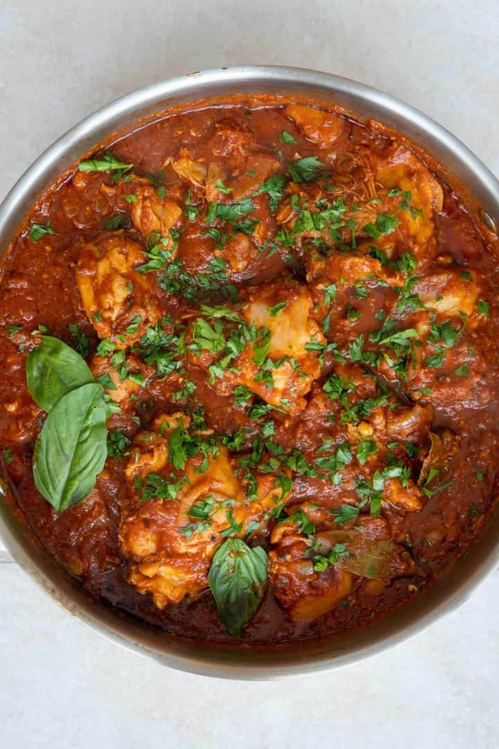 This Chicken in Arrabiata Sauce is made with bone-in chicken, onions, artichokes, Arrabiata sauce, and simmered into perfection.