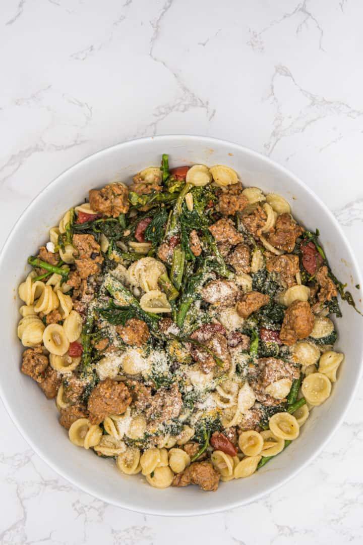 This Orecchiette with Sausage and Broccoli Rabe is made with sausage, broccoli rabe, garlic, diced tomato, and orecchiette pasta.