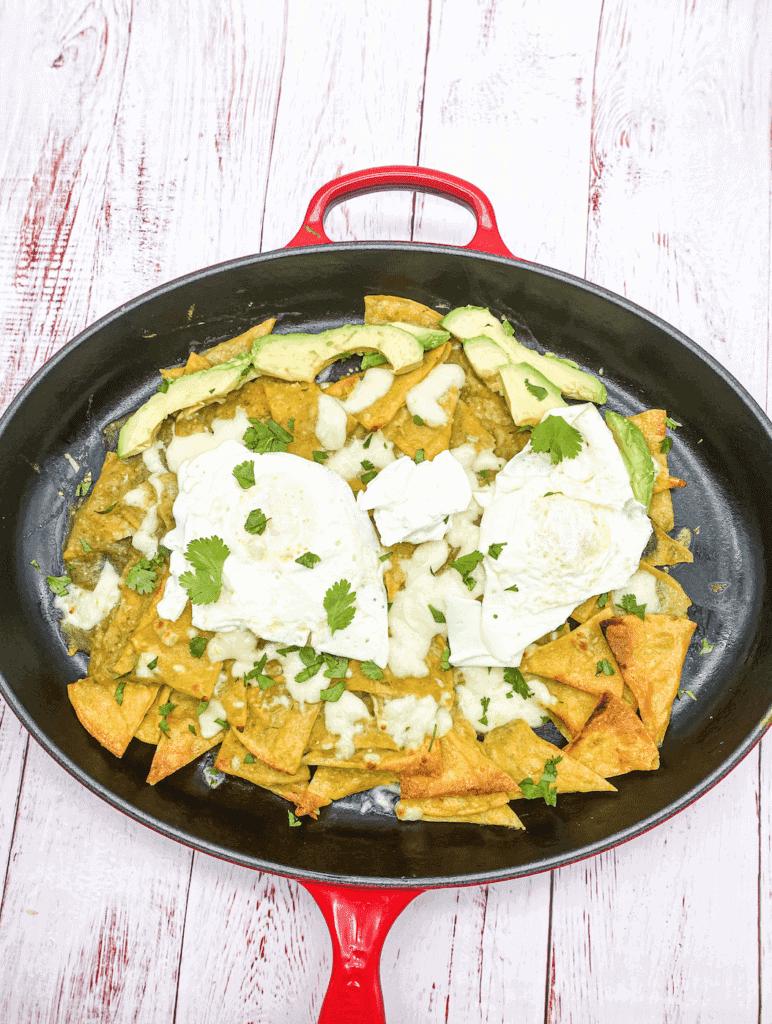 These are Chilaquiles verdes with eggs, avocado, cilantro, queso fresco, and Salsa Verde.