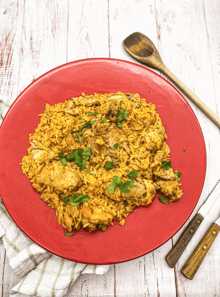 This Spicy Latin Chicken Paella is the best combination of Spanish Paella with saffron with an added Latin twist by adding sazón.