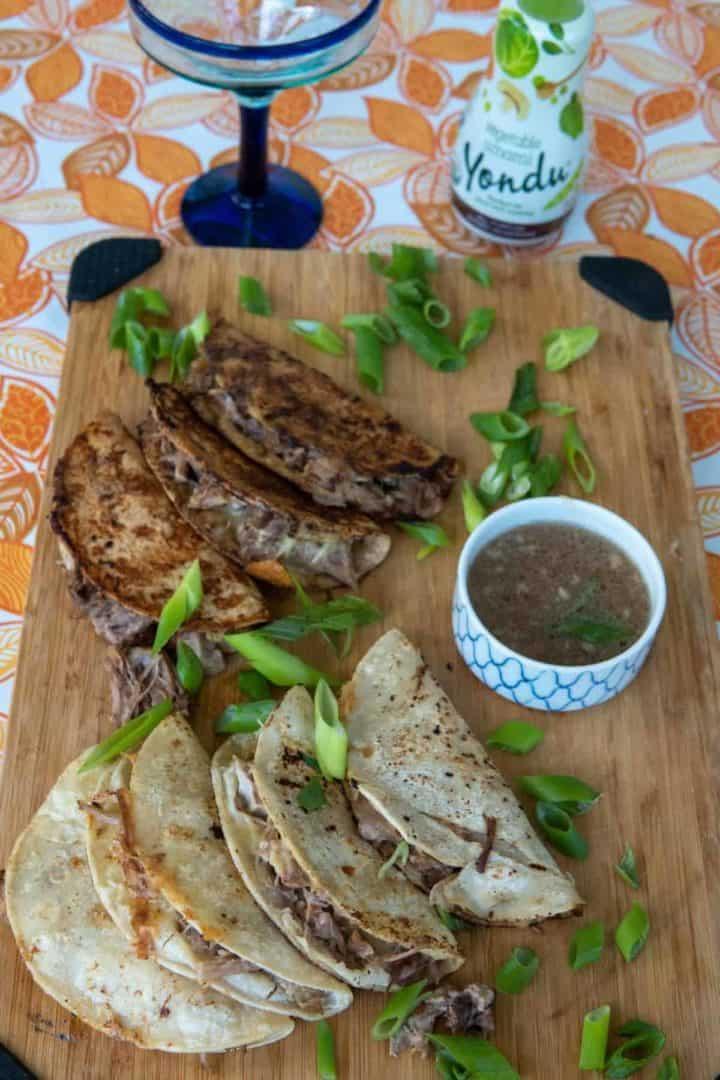 These Pork Cheese Birria Tacos are made with pork butt, vegetable umami, onion, garlic, mozzarella and corn tortillas.