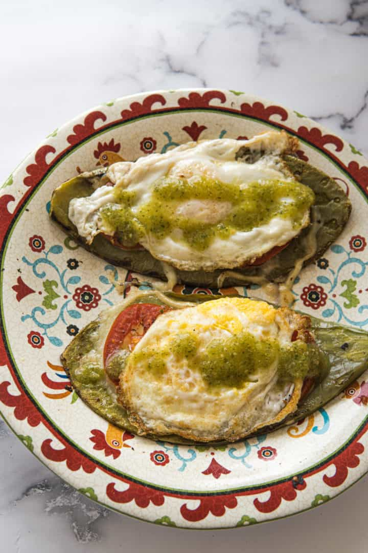 This Tomato, Egg, and Cheese on a Nopal is made with oil, cactus paddles, tomatoes, salsa verde, and eggs anyway you want them.