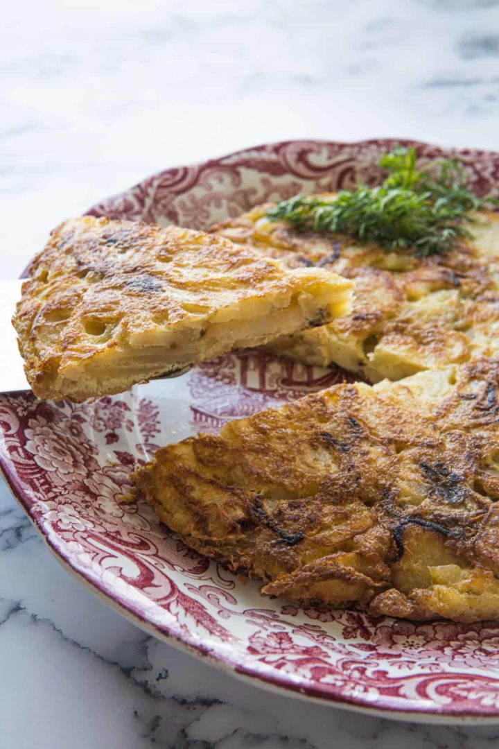This is a simple tortilla de patata recipe made with gold potatoes, yellow onion, eggs, and lots of olive oil.