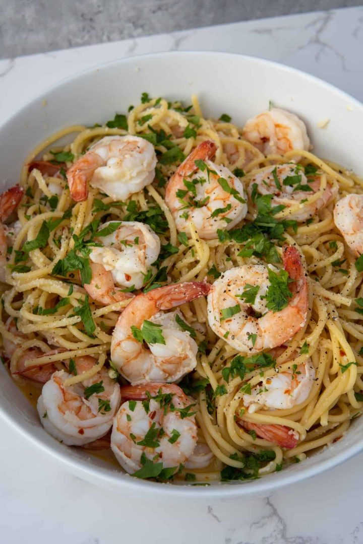 This Shrimp scampi is made with shrimp, butter, chicken broth, white wine, lemon juice, olive oil, red pepper flakes, parmesan and parsley.